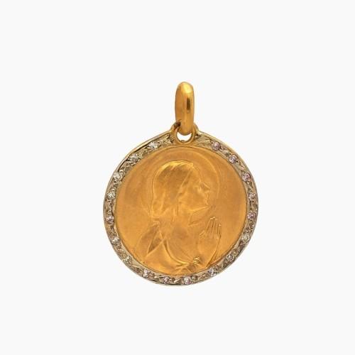 Medalla de oro y brillantes